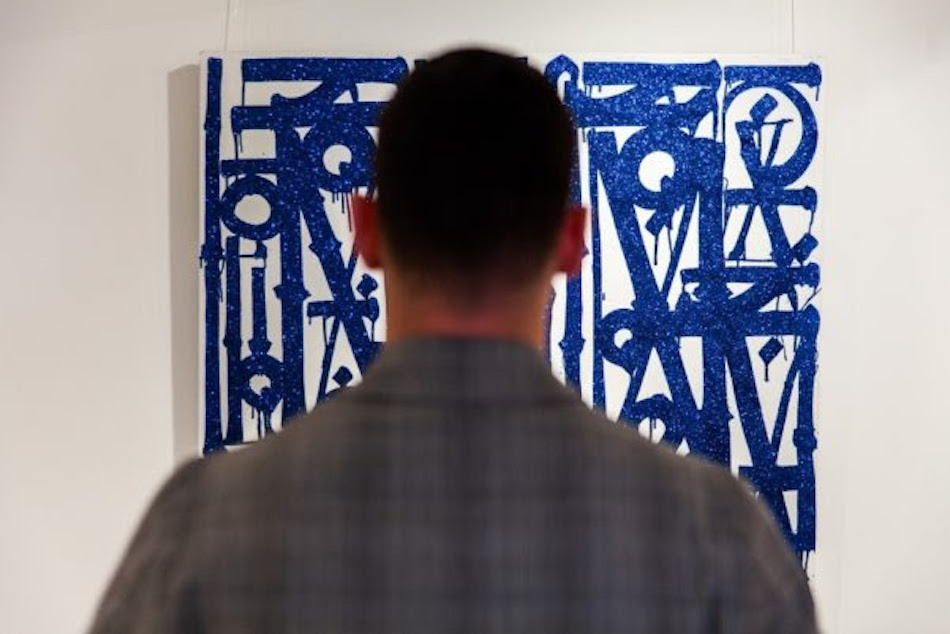 Art investor views Retna's Los Ne El Barrio
